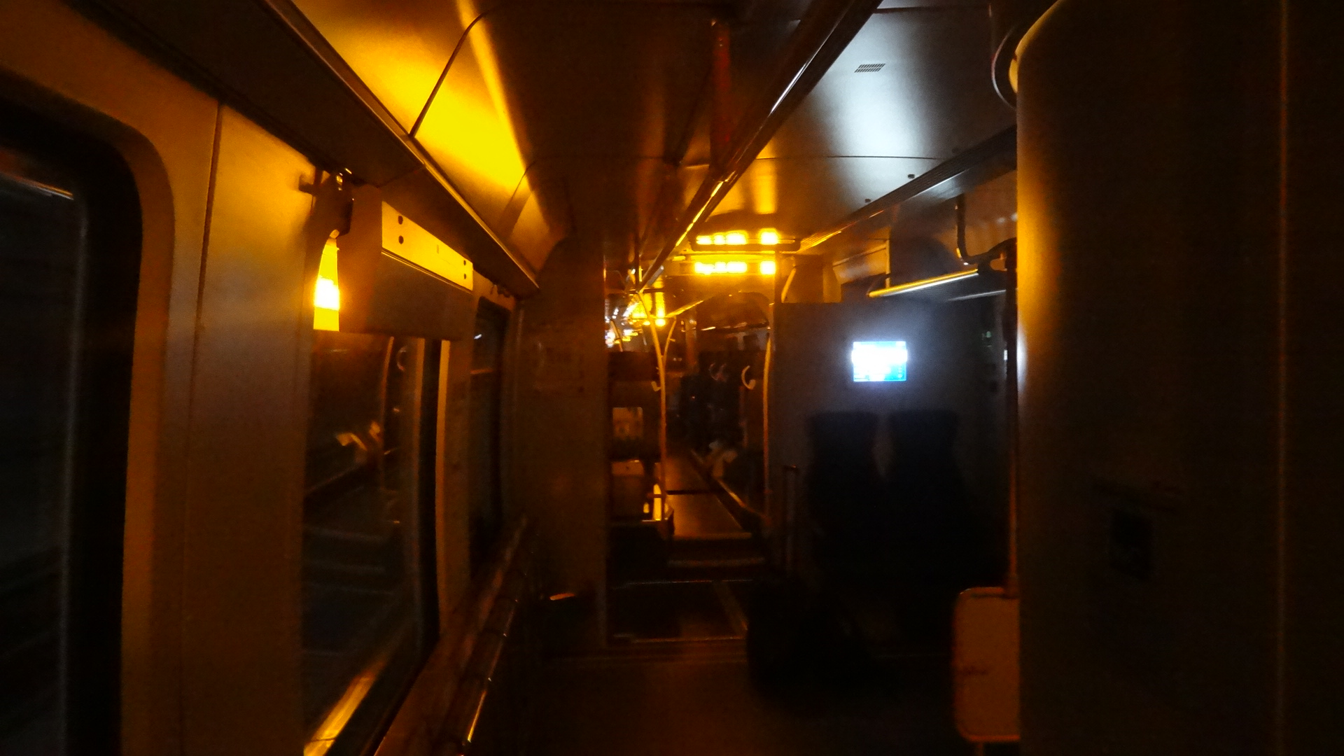 S-Bahn without interior lights inside a tunnel